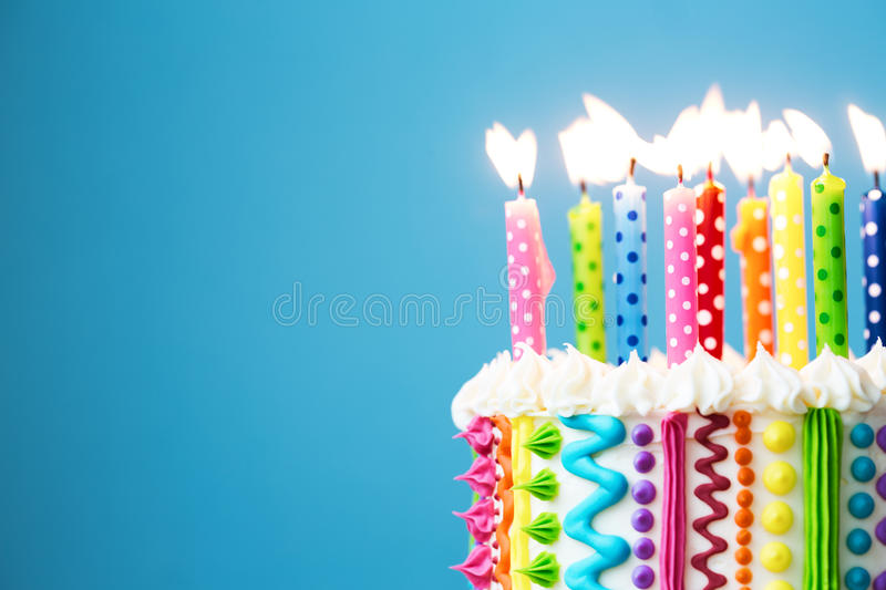 Colorful birthday candles. Birthday cake with colorful candles stock image