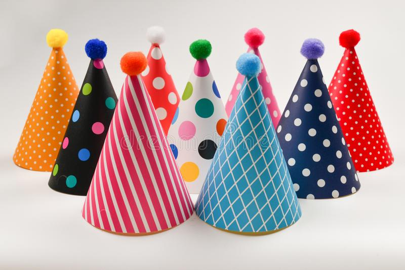 Colorful birthday caps on a white background stock images