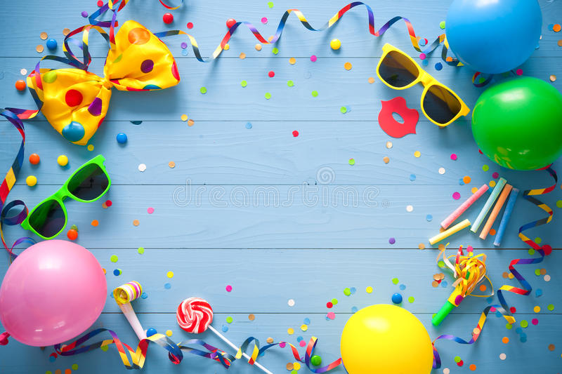 Colorful birthday or carnival background. Colorful birthday frame with party items on blue background. Happy birthday concept stock image