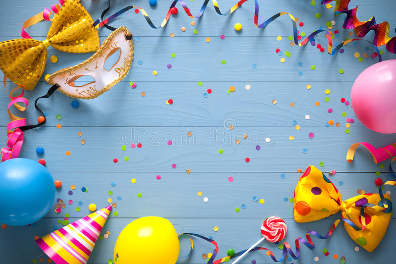 Colorful birthday or carnival background. Colorful birthday frame with party items on blue background. Happy birthday concept royalty free stock images