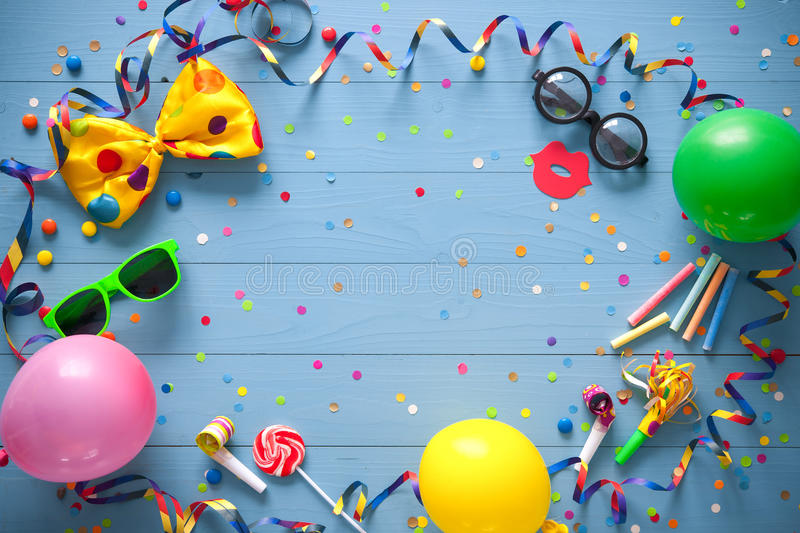 Colorful birthday or carnival background. Colorful birthday frame with party items on blue background. Happy birthday concept royalty free stock photos