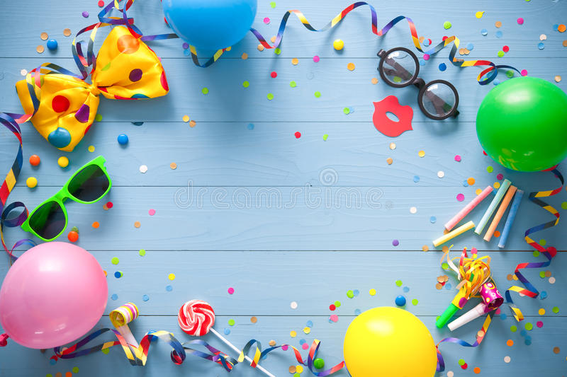Colorful birthday or carnival background. Colorful birthday frame with party items on blue background. Happy birthday concept stock photo