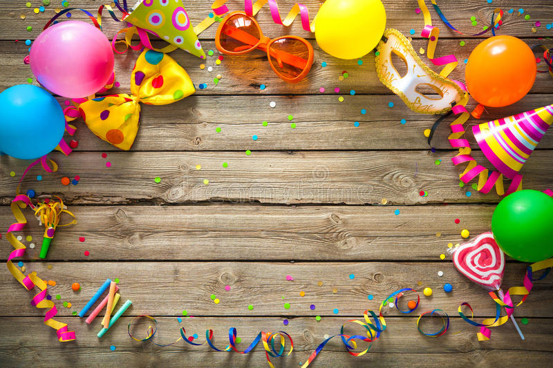 Colorful birthday or carnival background. Colorful birthday or carnival frame with party items on wooden background stock photography