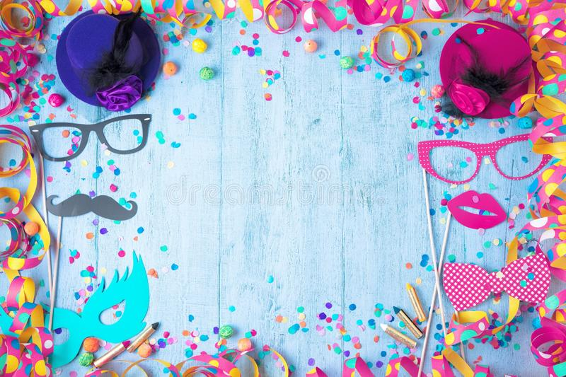 Colorful birthday or carnival frame with party items on wooden b. Ackground royalty free stock photography