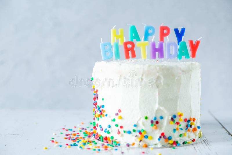 Colorful birthday concept - cake, candles, presents, decorations stock photos