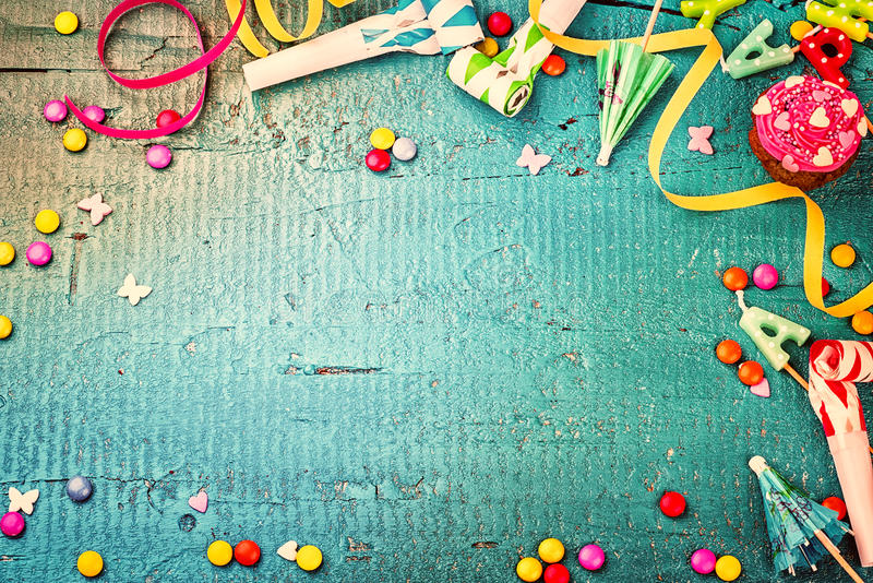 Colorful birthday frame with multicolor party items. Happy birth. Colorful birthday frame with multicolor party items on blue background. Happy birthday concept royalty free stock photos