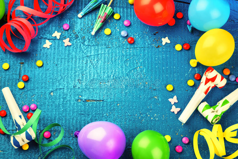 Colorful birthday frame with multicolor party items. Happy birth. Colorful birthday frame with multicolor party items on dark blue background. Happy birthday royalty free stock photography