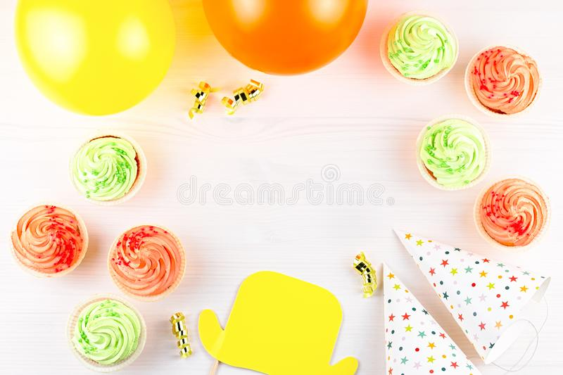 Colorful birthday party accessories on white. Wrapped gifts, confetti, balloons, party hats, decorations, copy space. Birthday party accessories and event stock image