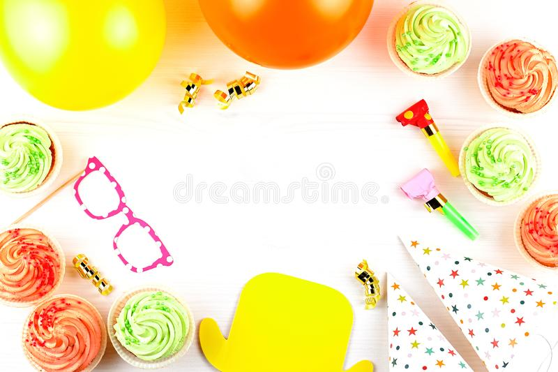 Colorful birthday party accessories on white. Wrapped gifts, confetti, balloons, party hats, decorations, copy space. Birthday party accessories and event stock photography