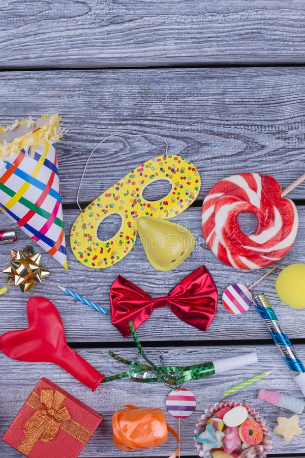 Colorful Birthday party supplies on wooden background. stock photo