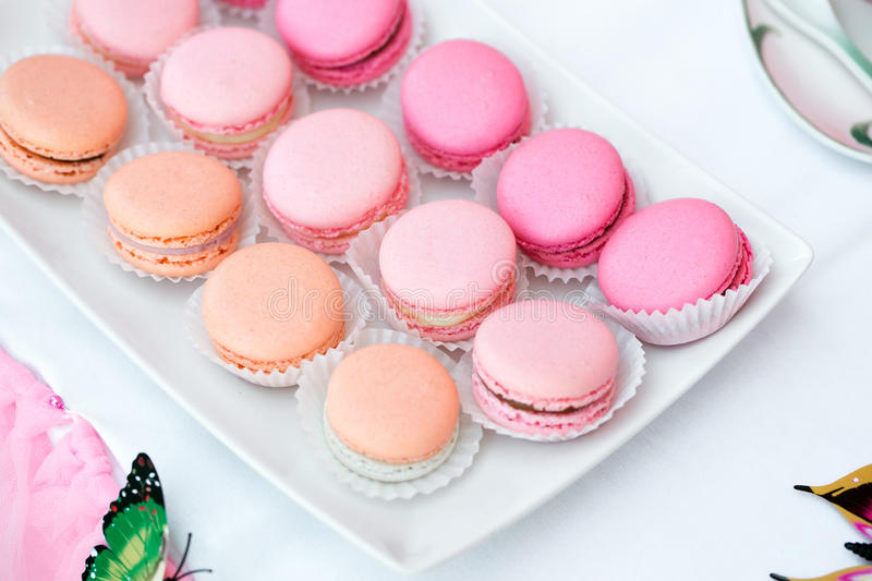 Colorful birthday party table with cake. macaroon close-up. Colorful birthday party table with cake, gift and homemade sweets for kids stock image