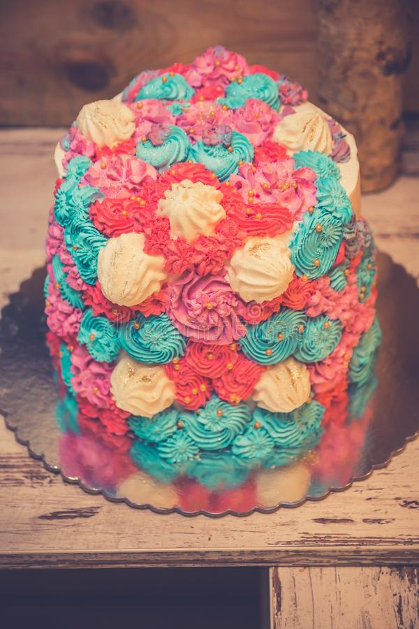 Colorful bizet cake. On the old wooden table in restaurant. Luxury delicious bizets at birthday celebration. Close up stock photo