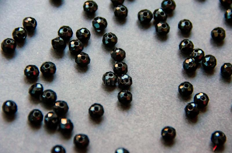 Colorful, black beads and stones isolated  grey background stock photography