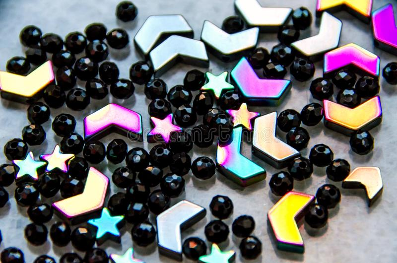 Colorful, black beads and stones isolated on grey background royalty free stock photos