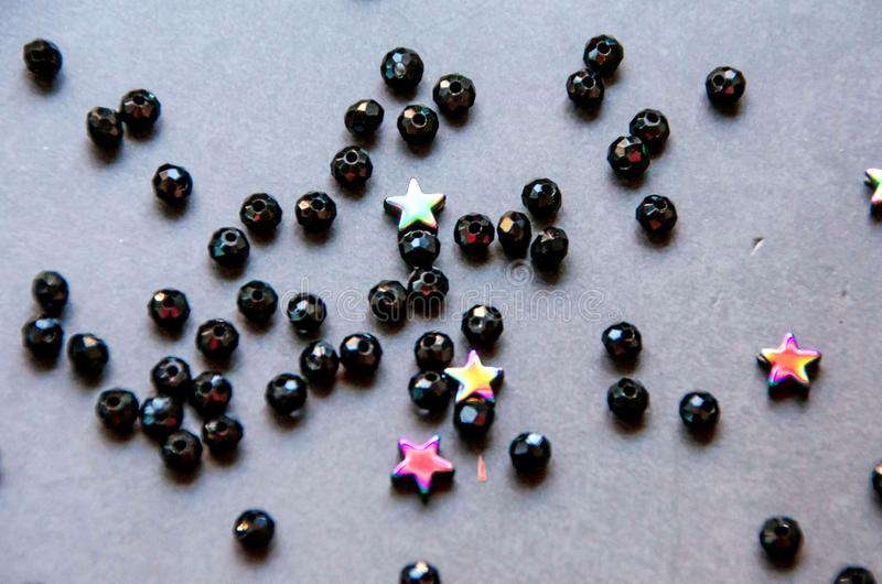 Colorful, black beads and stones isolated  grey background royalty free stock photo