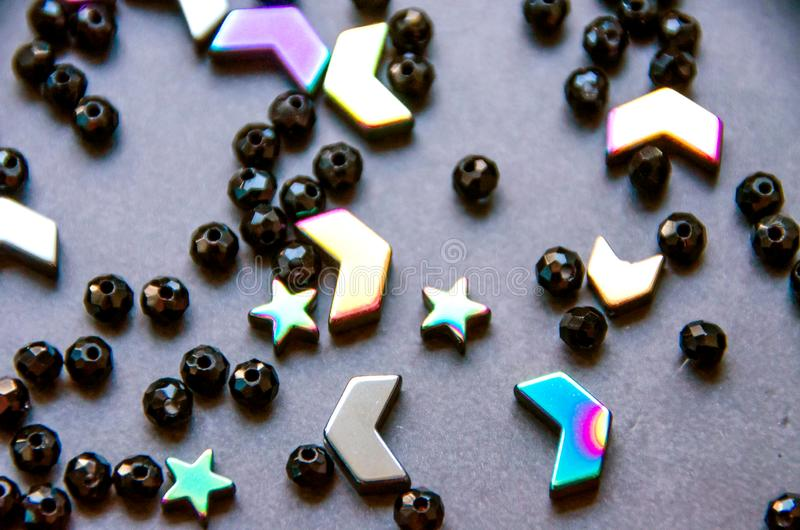Colorful, black beads and stones isolated on grey background stock photos