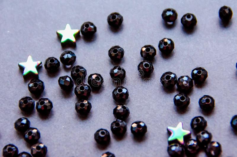 Colorful, black beads and stones isolated on grey background stock photo