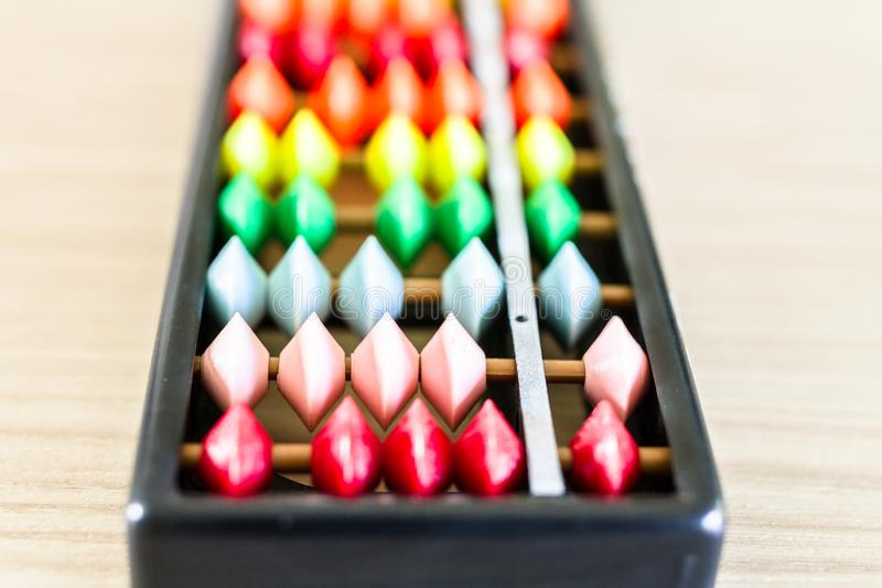 Colorful black Chinese abacus. stock photos
