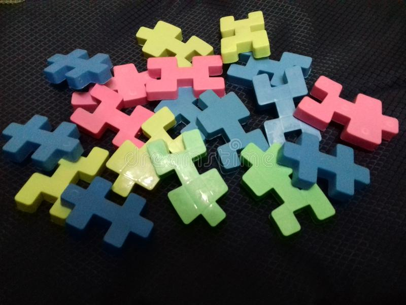 Colorful blocks for children on black background stock images