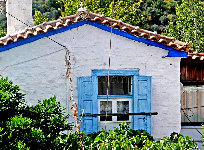 A colorful blue colored house on the Greek island of Samos. The green and lush Samos island is located in the northern part of the Aegean Sea, just a few meters stock image
