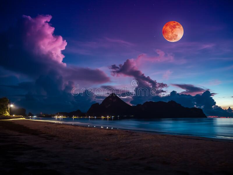 Colorful blue sky with cloud and bright full moon on seascape to night royalty free stock image