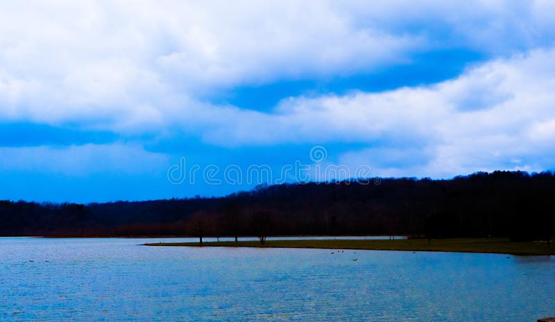 Colorful blue sky and lake. stock photo