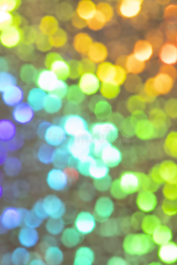 Bright and colorful bokeh background. Colorful blurred wallpaper, bright and vivid bokeh background. Vertical image abstract christmas art backdrop beautiful royalty free stock images