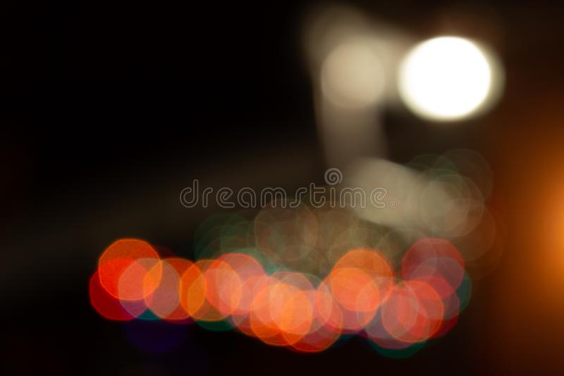 Colorful blurry lights. Yellow, blue, red. garland in blur. Night. Black background. Colorful blurry lights. Yellow blue red garland in blur. Night. Black stock images