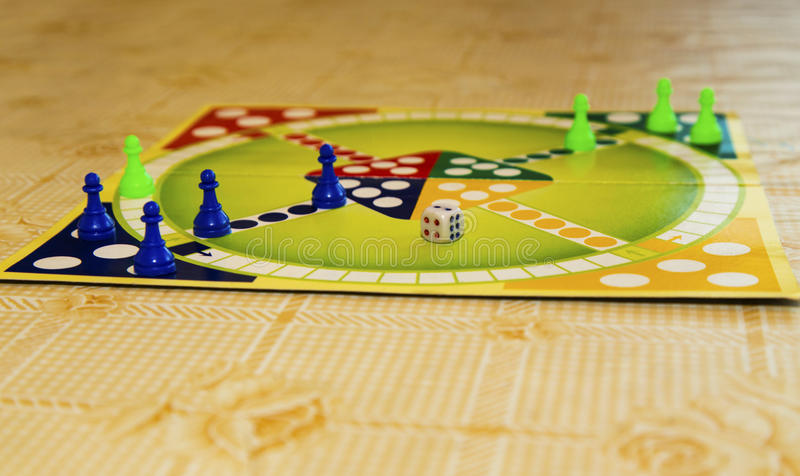 Colorful board for playing traditional children`s game royalty free stock images