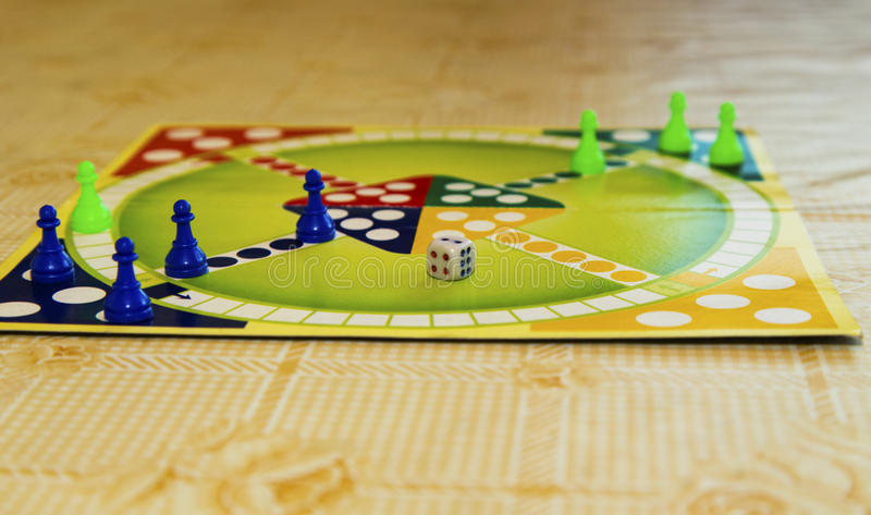 Colorful board for playing traditional children`s game royalty free stock photos