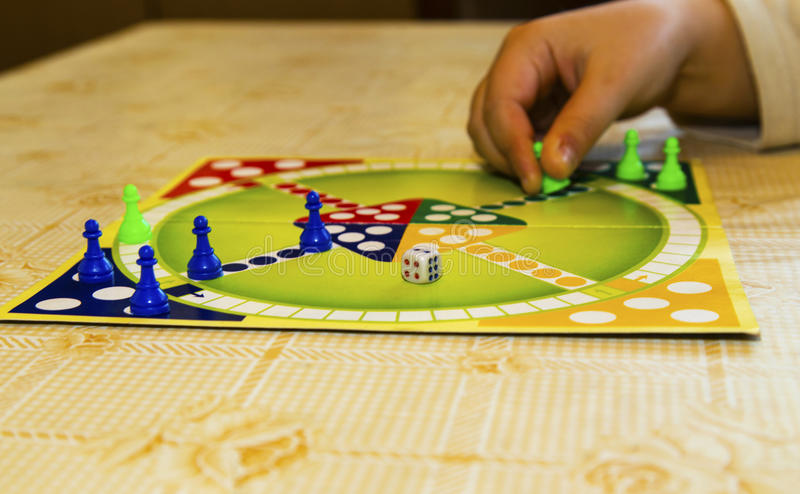 Colorful board for playing traditional children`s game stock images