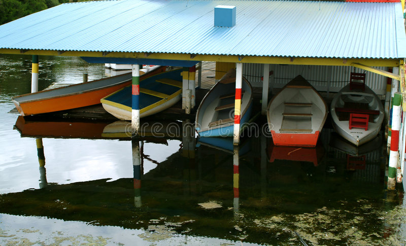 Colorful boat house. Colorful rowboat house stock photo