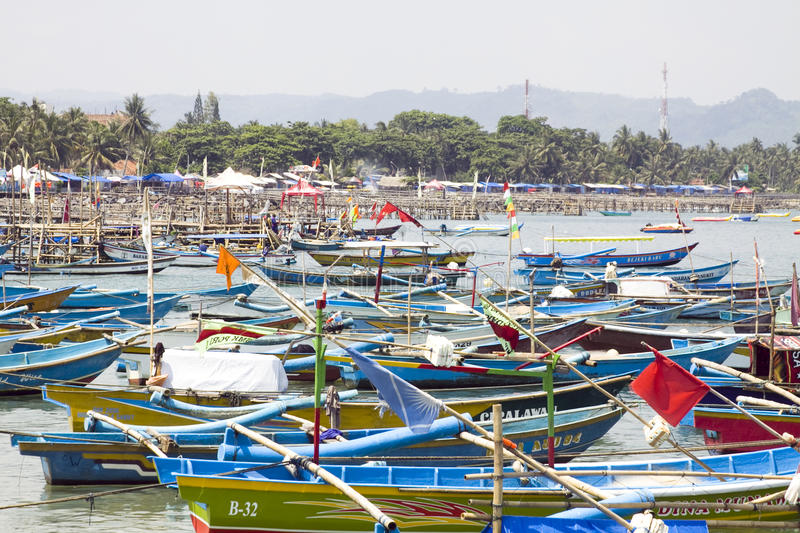 Colorful boats on beach in Indonesia. Hundreds of colorful boats on a beach in Pangandaran, Indonesia royalty free stock image