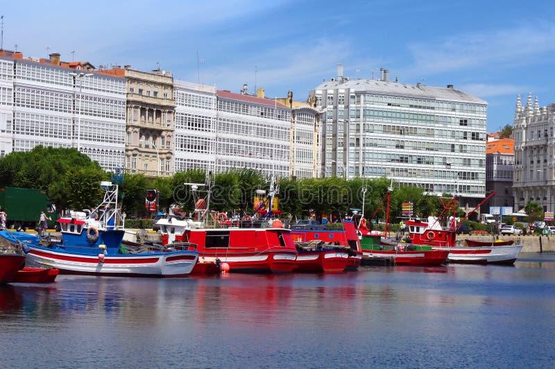 Colorful boats in Coruña marina stock photo