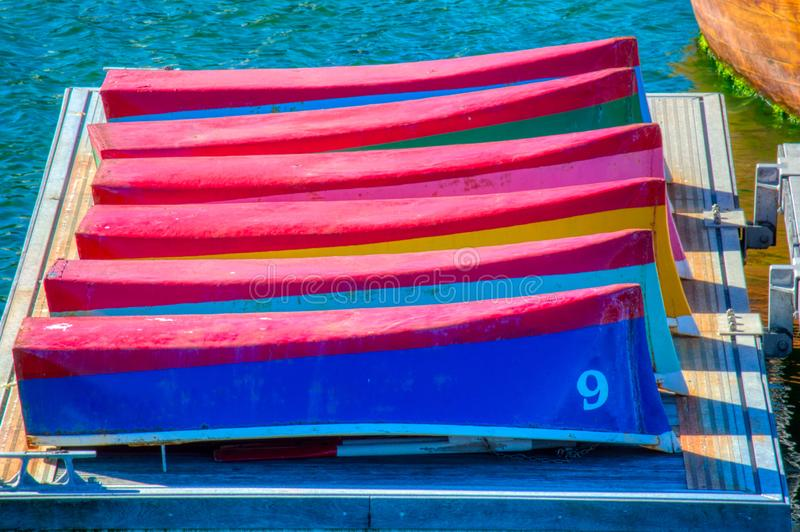Boats Scene. Colorful sailing boats on the pier. Colorful boats i found walking down the beach. Colorful sailing boats on the pier stock image