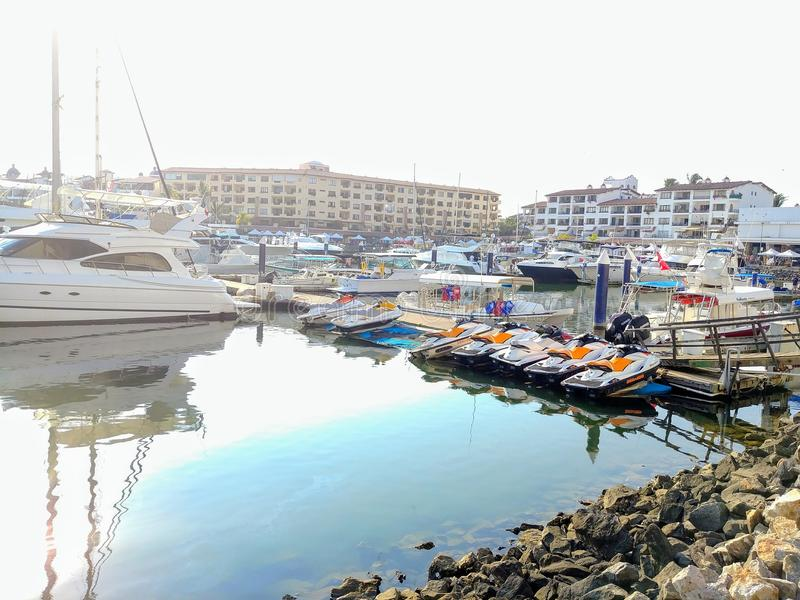 Colorful boats on the marina on a bright sunny day. stock photo