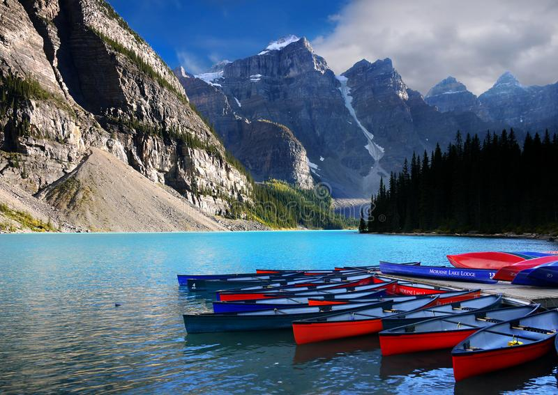 Moraine Lake Boats, Banff NP, Canada. Colorful boats on Moraine Lake in Canadian Rockies. Banff National Park. Alberta Canada royalty free stock photo