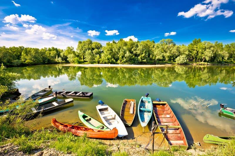 Colorful boats on mouth of Drava and Mura rivers. Podravina region of Croatia stock photography