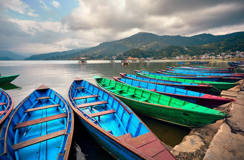 Colorful boats in Pokhara royalty free stock photo