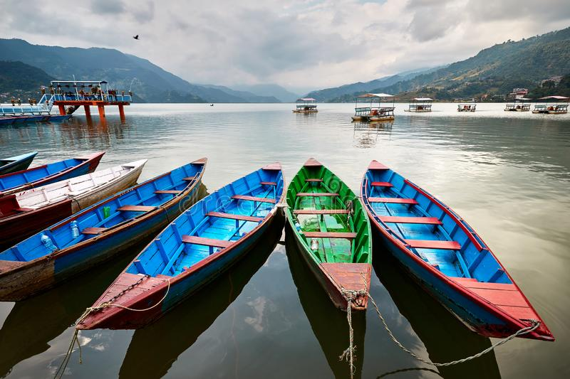 Colorful boats in Pokhara stock photo