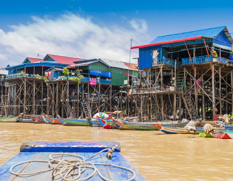 Colorful boats and stilt houses in Kampong Phluk floating village, Tonle Sap lake, Cambodia. Colorful boats and stilt houses in Kampong Phluk floating village royalty free stock photo