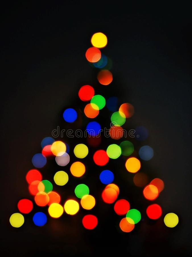 Colorful bokeh of Christmas tree black background royalty free stock photo