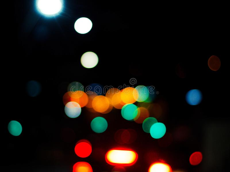 Colorful bokeh lights on black royalty free stock photos