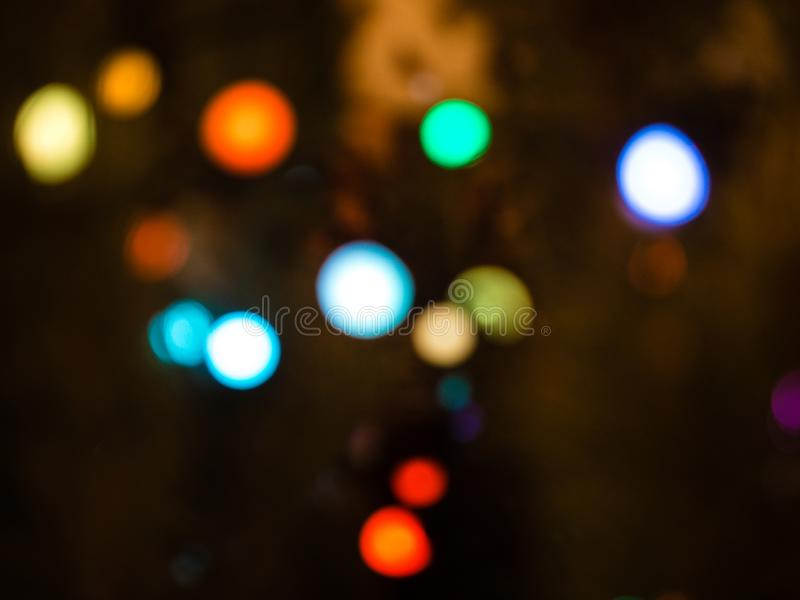 Colorful bokeh. Unfocused abstract colourful bokeh on black background. defocused and blurred many round light.  royalty free stock photography