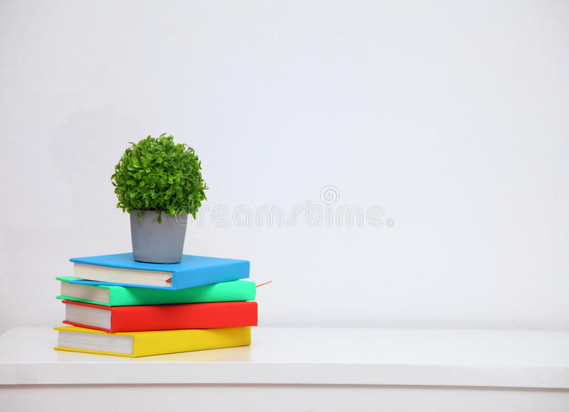 Colorful book on console white table stock images