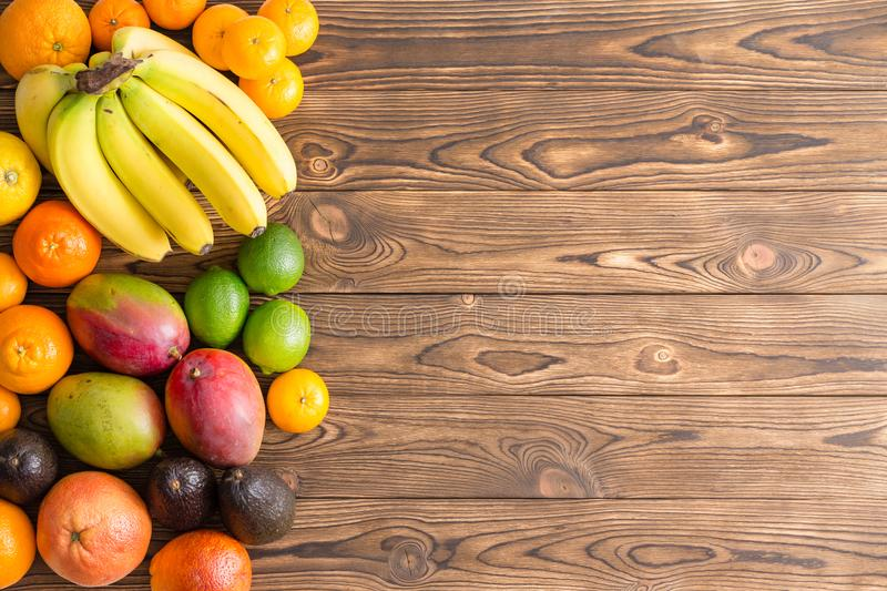 Colorful border of assorted fresh tropical fruit royalty free stock image
