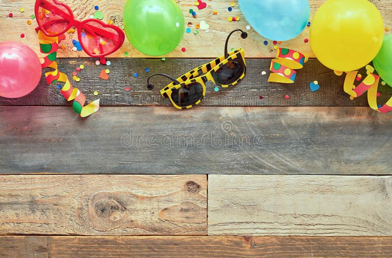 Colorful border of carnival or party accessories stock photos