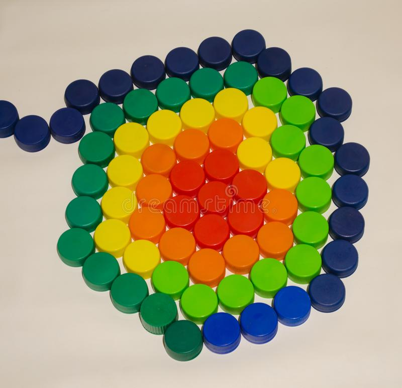 .Colorful bottle caps grouped on white background. Colorful bottle caps grouped on white background. Recycling and environmental care stock images