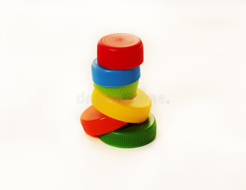 Colorful bottle caps. Six colorful bottle caps isolated on white background stock photos