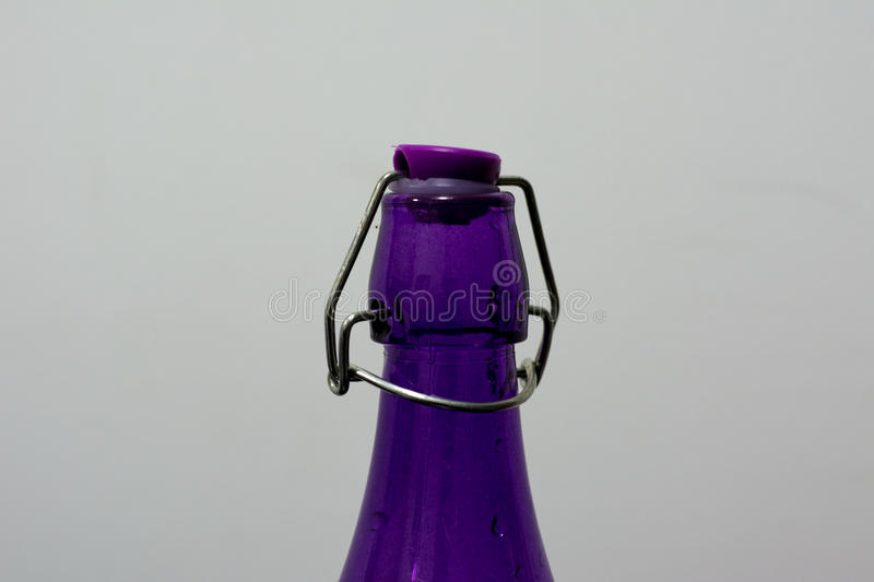 Colorful bottle made up of glass. SIngle bottle of water made up of colorful glass stock photo